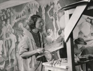 Elizabeth Deering painting a mural at Forham Hospital - in black and white