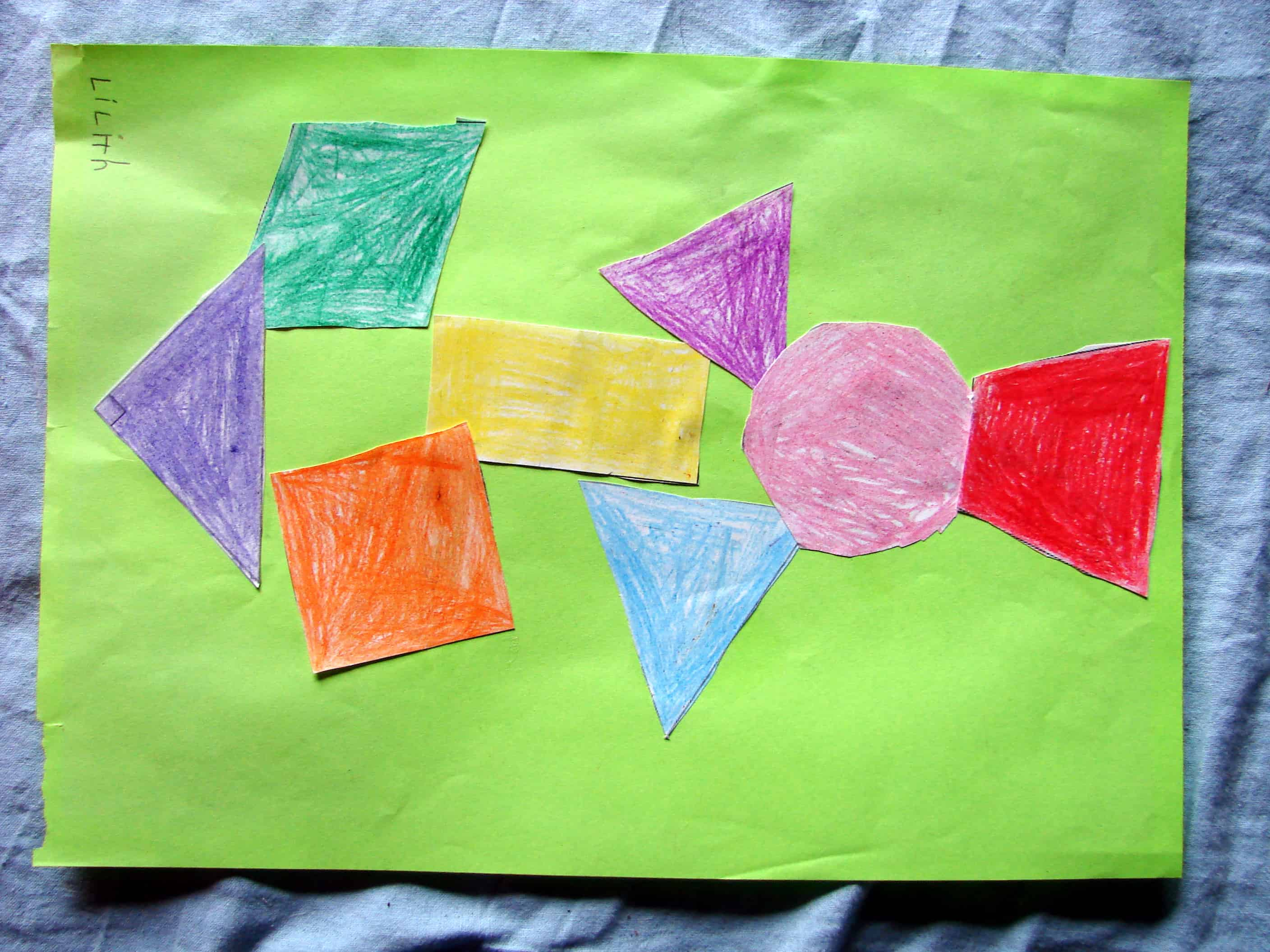 An artwork my daughter made pasting pieces of paper in geometrical shapes