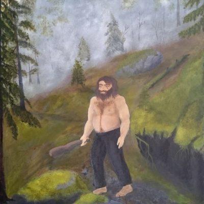 Mandig troll i skogen på en tåkete morgen