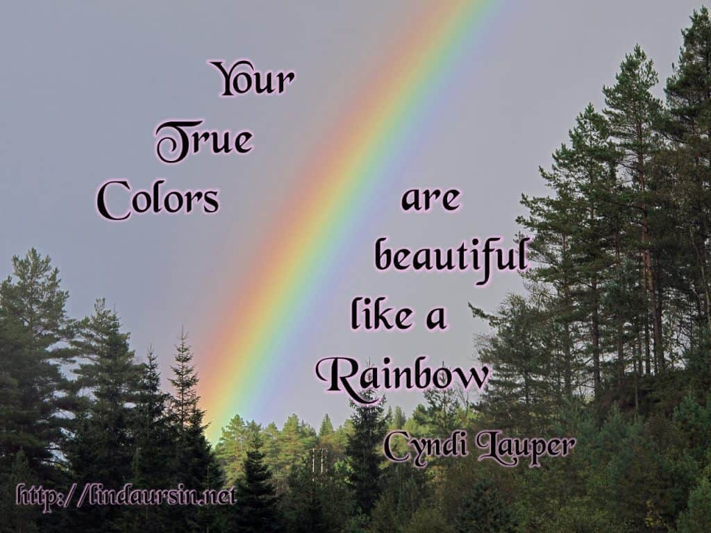 "Picture of a rainbow over trees with the quote ""Your true colours are beautiful like a rainbow"
