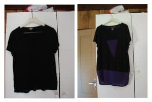 Black t-shirt that's too short on the left, lengthened by adding a strip of purple at the bottom, plus adding a purple triangle below the neckline on the right