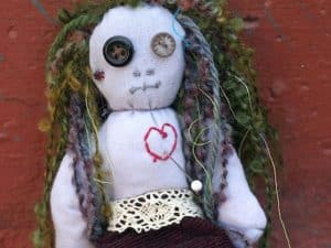 A picture of a voodoo doll pincushion