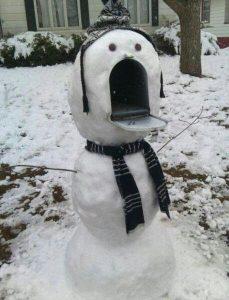 Snowman built over a mailbox