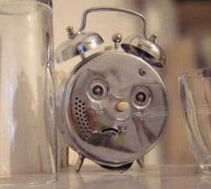 The back of an alarm clock looking like a sad face