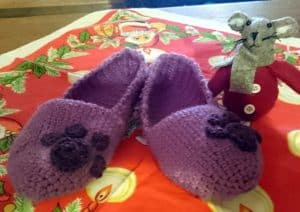 A picture of the finished purple slippers with cat's paw prints