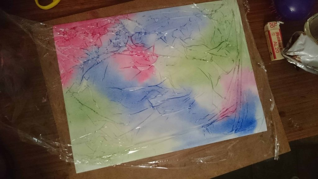 Watercolour covered by plastic wrap
