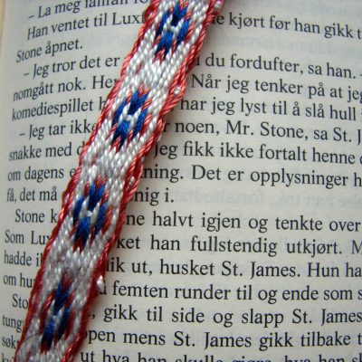 Circled H tablet-woven bookmark closeup