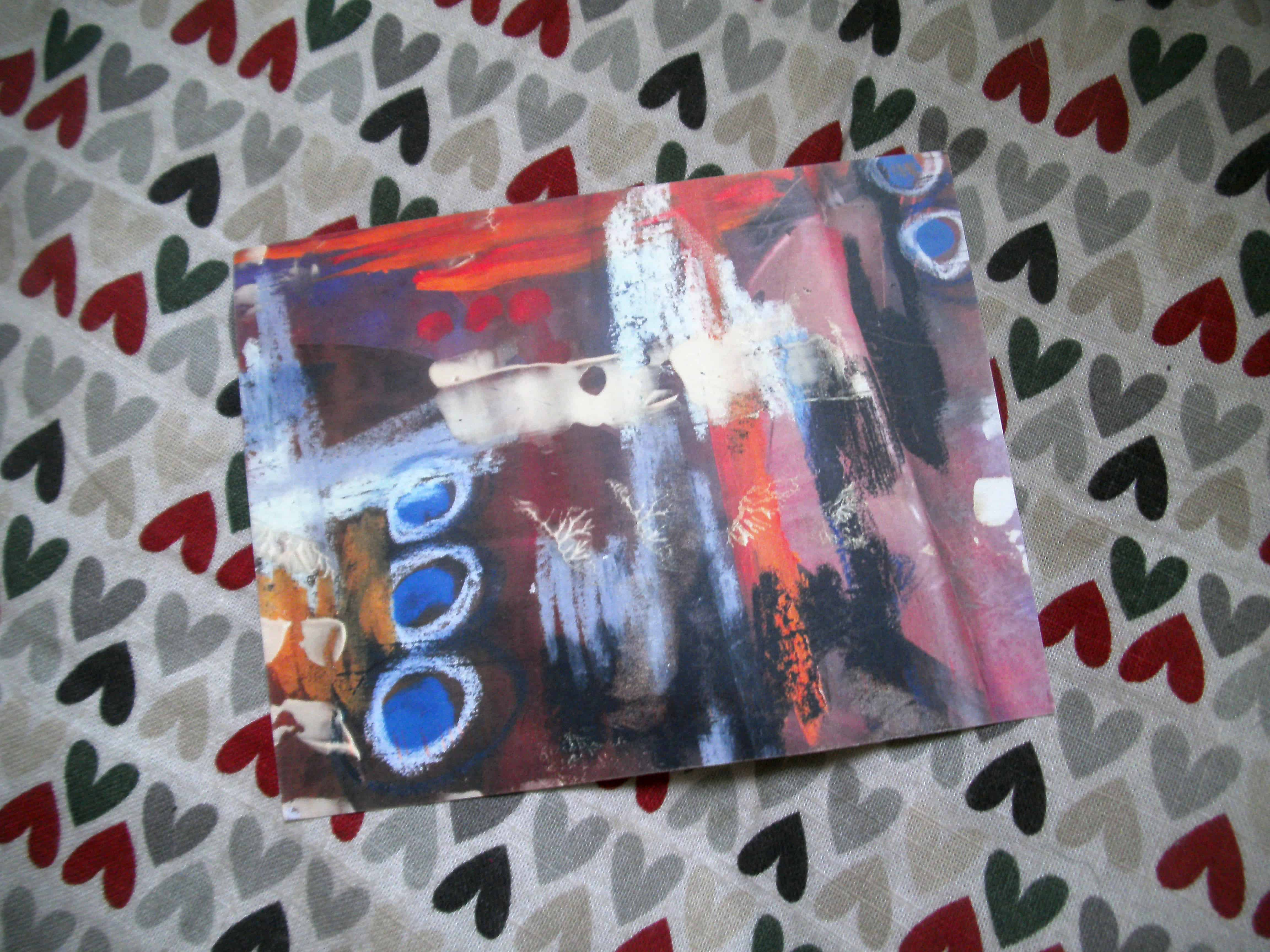 A painting in acrylic and oil pastels in an altered photography book by Patsy J. Lawrence, USA