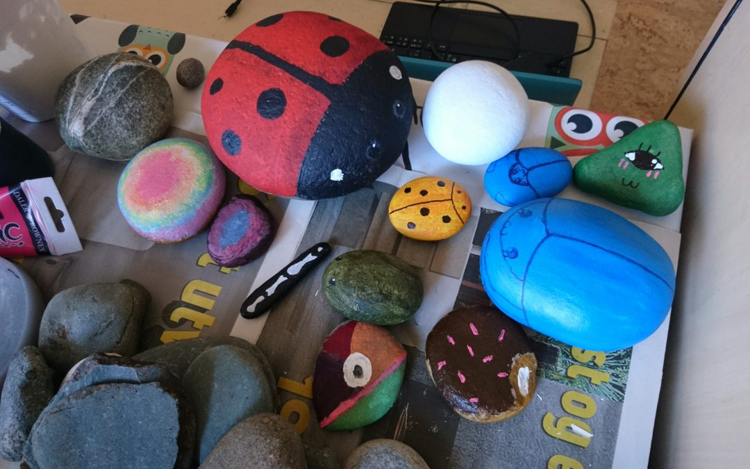 Painting stones for the garden with my daughter